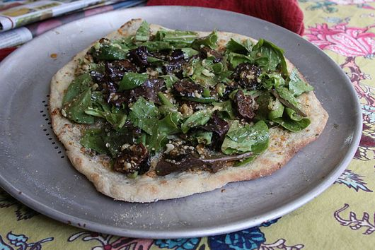 Herbed salad flatbread with fig, pecan vinaigrette