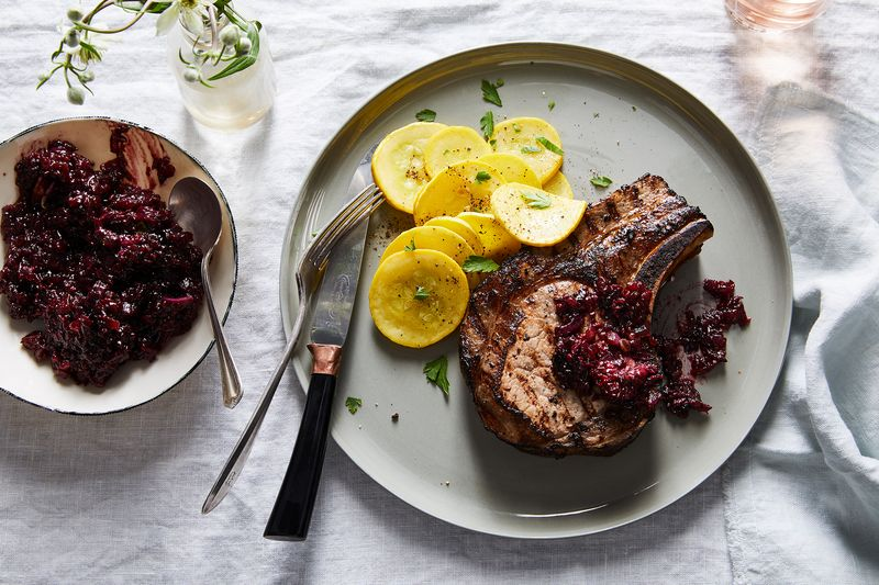 Summer berries do double duty as marinade and sauce for grilled pork chops.