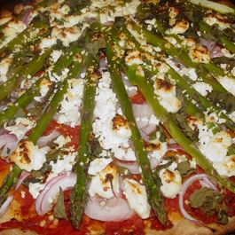 Whole Wheat Pizza with Sundried Tomato Puree, Red Onions, Asparagus, and Goat Cheese