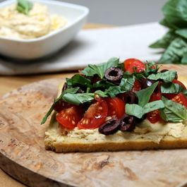 Hummus Tartine with an Olive, Tomato, Lemon & Basil Salsa