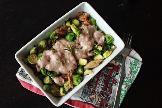 Crunchy chicken and brussel sprouts in the oven with a melted cheese and wine sa