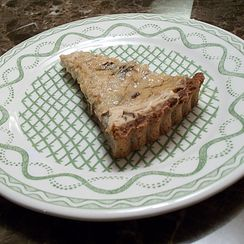 Prune and Goat Cheese Tart with Walnut Spice Crust