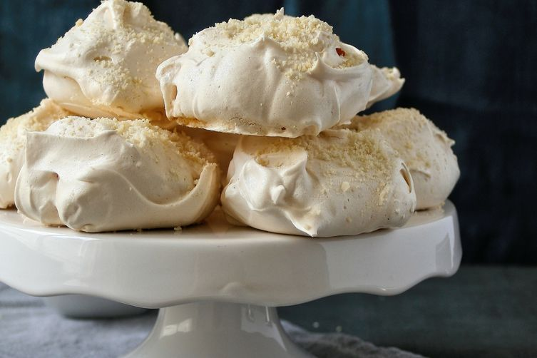 Vanilla bean and almond meringues with a mixed berry sauce.