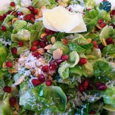 BRUSSELS SPROUT SALAD WITH POMEGRANATE SEEDS, PECORINO CHEESE, AND HONEY ROASTED