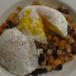 Mixed potato hash with bacon and eggs