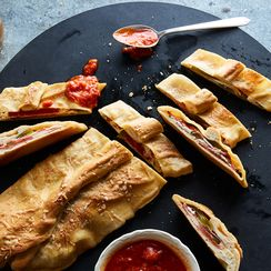 This Cheesy, Saucy Stromboli Is a Giant Pizza Pocket for Meat Lovers