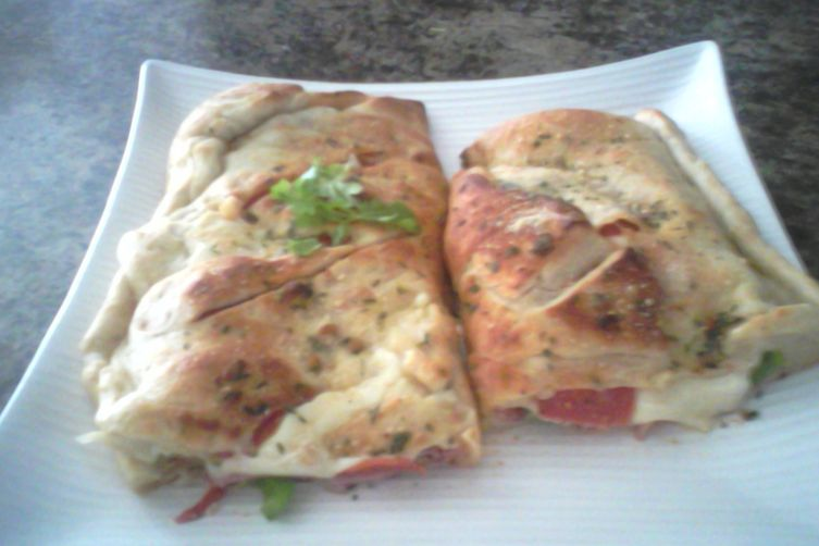 Italian calzone with asaigo and olive oil crust