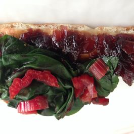 Red onion marmalade, anchovy and Swiss chard flatbread crostini