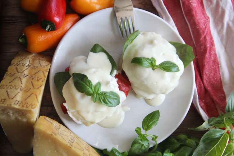 Eggs Benedict with Grana Padano Cheese Sauce, Prosciutto and Roasted Red Peppers