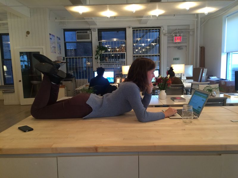 Amanda Sims takes the most comfortable position in the office for full agility to answer questions.