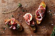 Ricotta Crostini with Figs, Prosciutto, and Honey