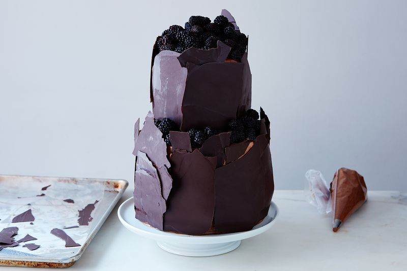 Little peeks (and peaks!) of blackberries and chocolate frosting behind shiny walls of tempered chocolate.