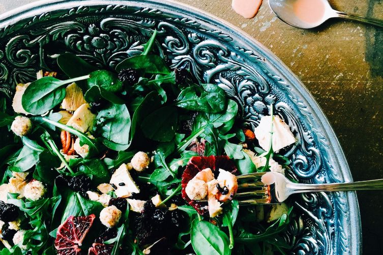 pecan-crusted goat cheese salad with blood orange tahini dressing