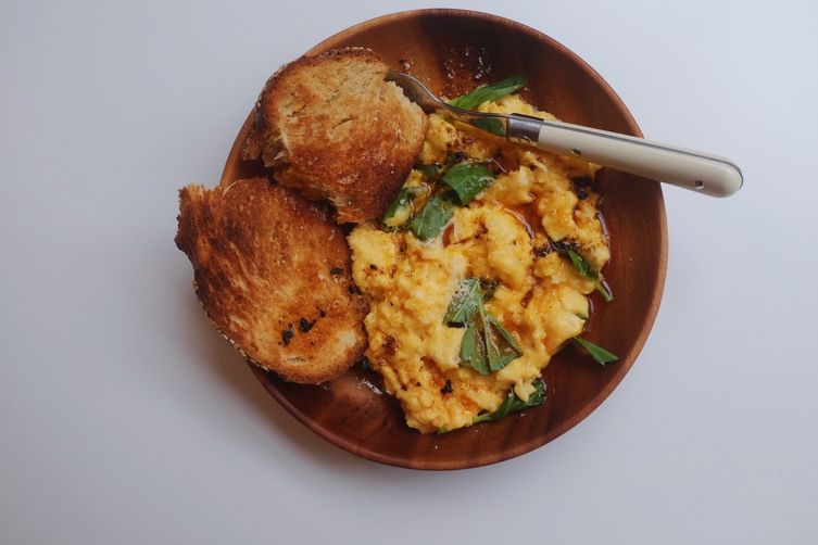 Super Fluffy Scrambled Eggs with Basil and Chipotle Butter