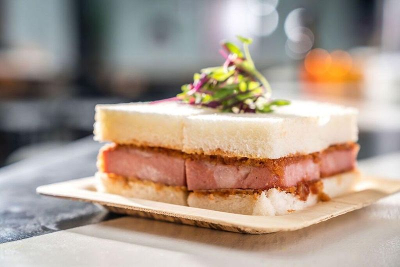 At Katana Kitten in NYC, the chef fries a thick slab of mortadella like a cutlet.