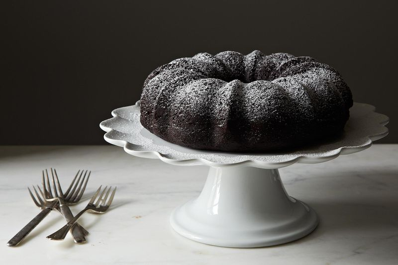 Because all the surface area will be on display, and parchment can't line the bottom, flour and grease a Bundt pan thoroughly.