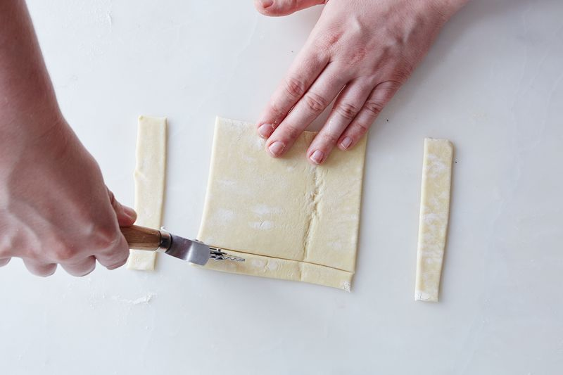 Use a sharp tool! A pastry wheel's a great choice (but so is a bench cutter or a paring knife).