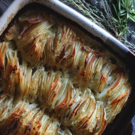 Scalloped Potatoes in Herbed Parmesan Cream