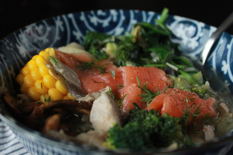 Salmon soup with mushrooms, broccoli, spinach and corn