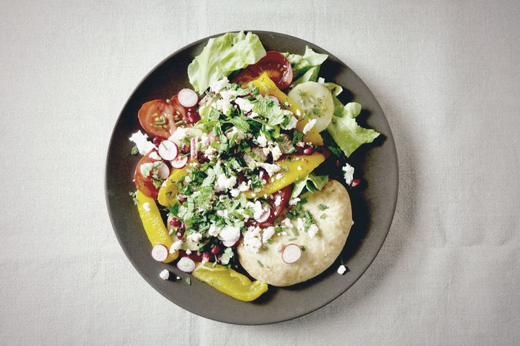 Vegetarian salad with feta, yellow pepper and pita