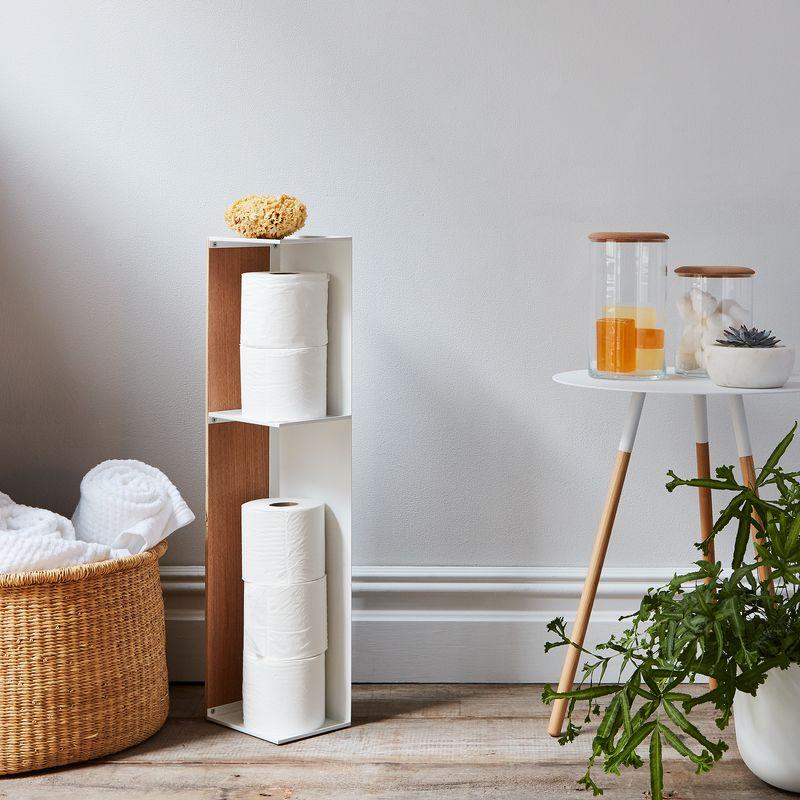 A slim shelf waiting to make its home in a bathroom corner.