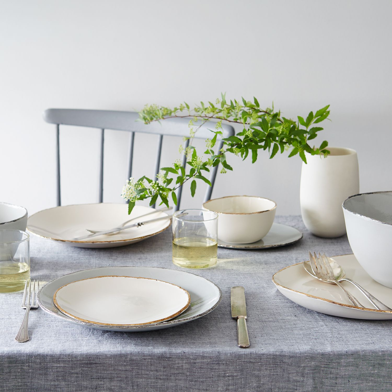 porcelain goldrimmed dinnerware on food -