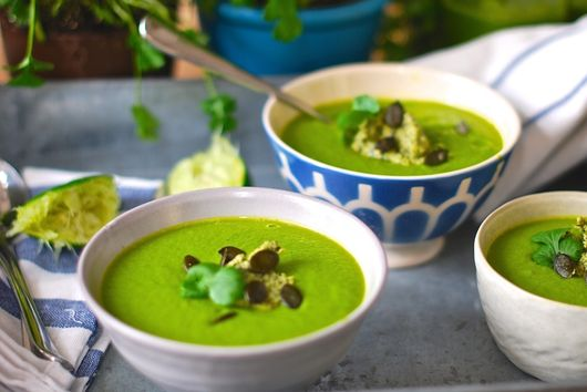 Creamy vegan super soup with avocado pumpkin seed mousse