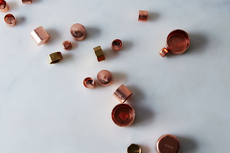 Turn most anything into a candle-holder with a copper end cap and epoxy.