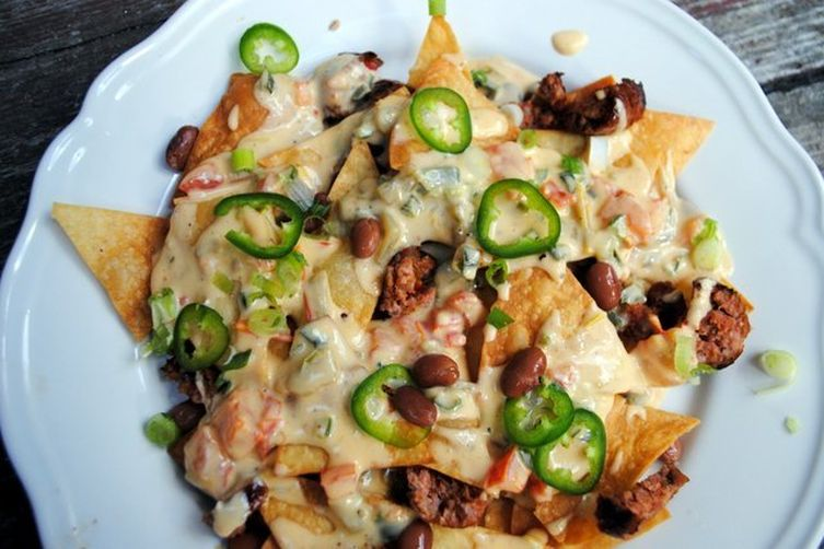 SAUCY NACHOS WITH P-P-P-PEPPERED QUESO