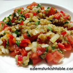 Smoked eggplant salad with tomatoes and onions with olive oil, lemon and mint