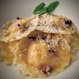 homemade pumpkin ravioli with hazelnut sauce