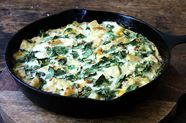 Skillet Strata with Bacon, Cheddar, and Greens