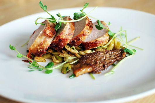 Pancetta Wrapped Pork Tenderloin with Spring Vegetables