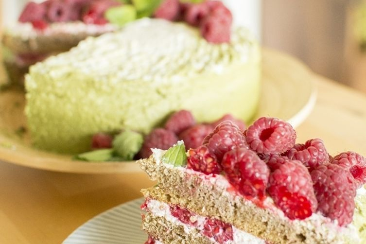 Matcha cake with coconut cream and raspberries