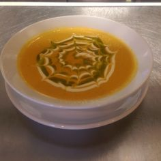 yellow tomato soup with creme fraiche and basil oil