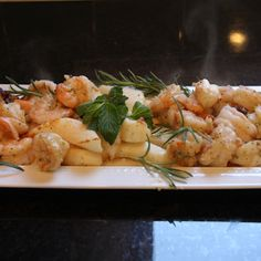 Shrimp and Calamari with Mint Pesto on Sprigs of Rosemary.