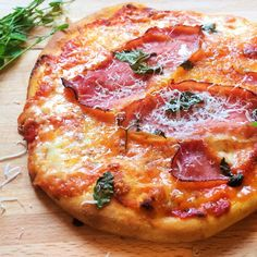 Simple pizza recipe with garlicky tomato sauce and Red Leicester
