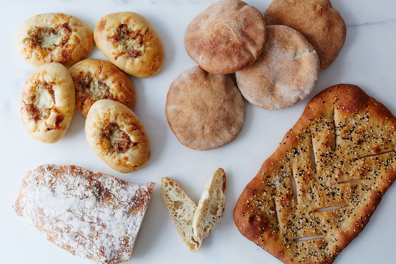 You can adapt any (!) bread recipe with nearly any preferment by using baker's percentages. Make bialys with sponge, pita with poolish, fougasse with pâté fermentée, or ciabatta with biga.