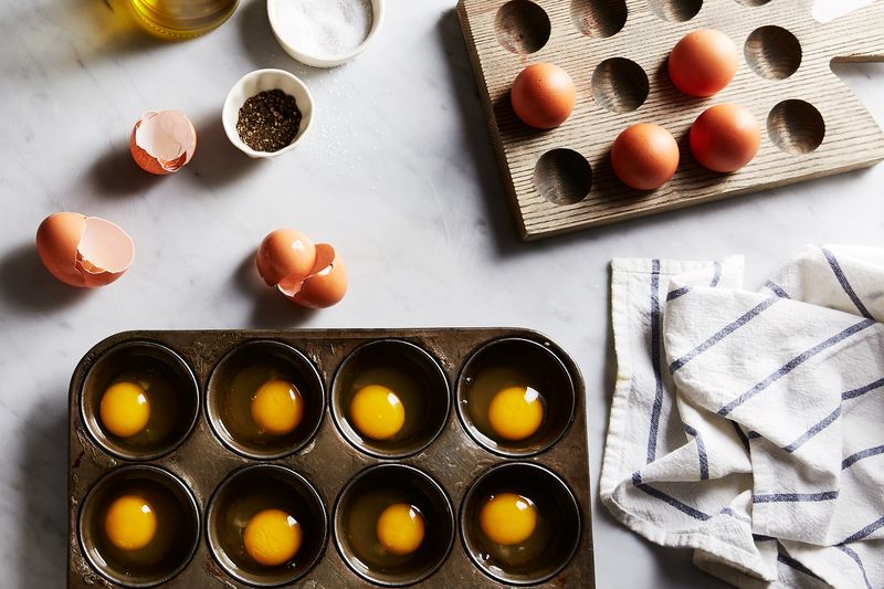 The easiest way to poach a dozen eggs at once: in a muffin tin.