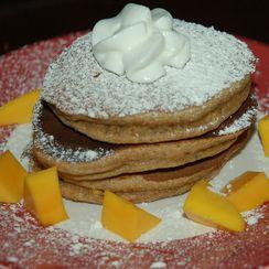 Spelt-Pistachio-Cardamom Pancakes with Mango and Cream