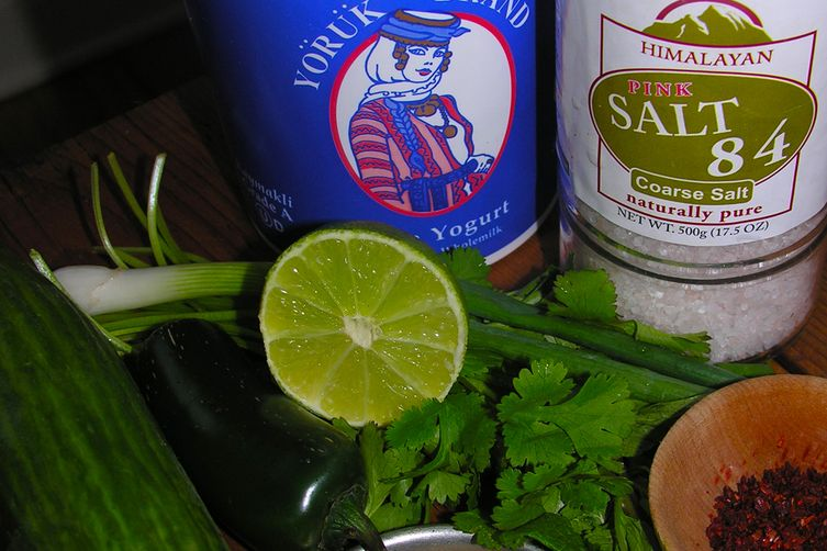 Cool, muddled cucumber raita with a happy hour option