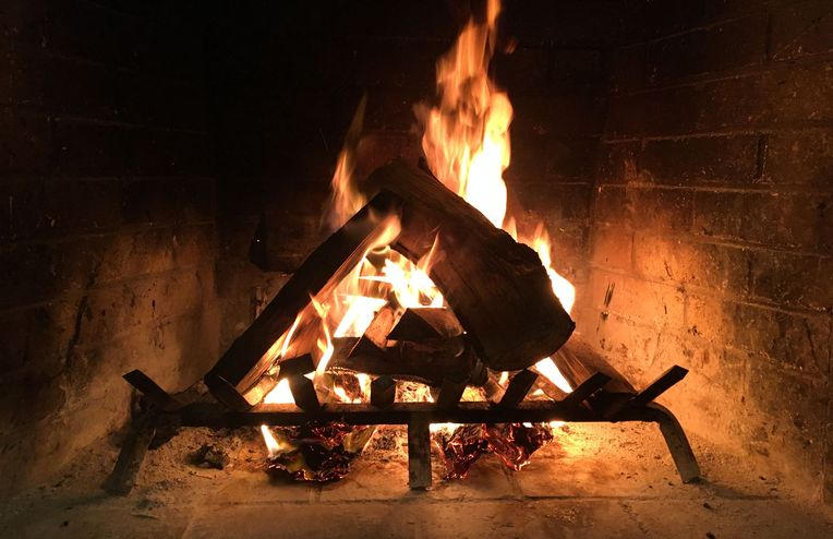 How to Start a Fireplace Fire (& Keep It Going All Night)