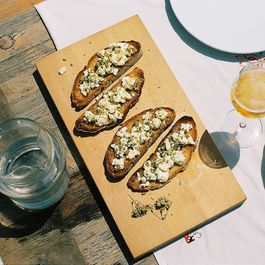 The best crostini with diced capers, crumbed feta & oregano