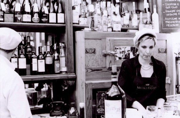 Nicoletta behind the bar at Casa del Vino.