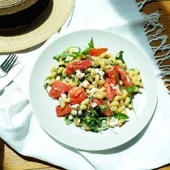 Summer pasta salad with feta, arugula, tomatoes & black olives