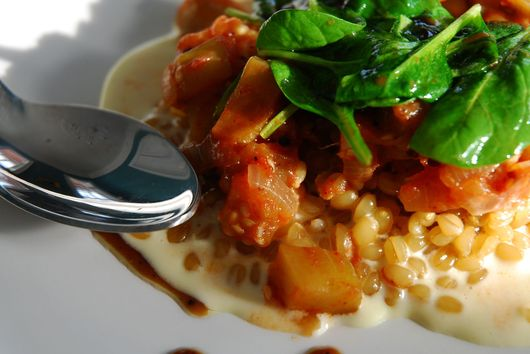Creamy White Wheat Berry Porridge with Eggplant Stew and Wilted Spinach
