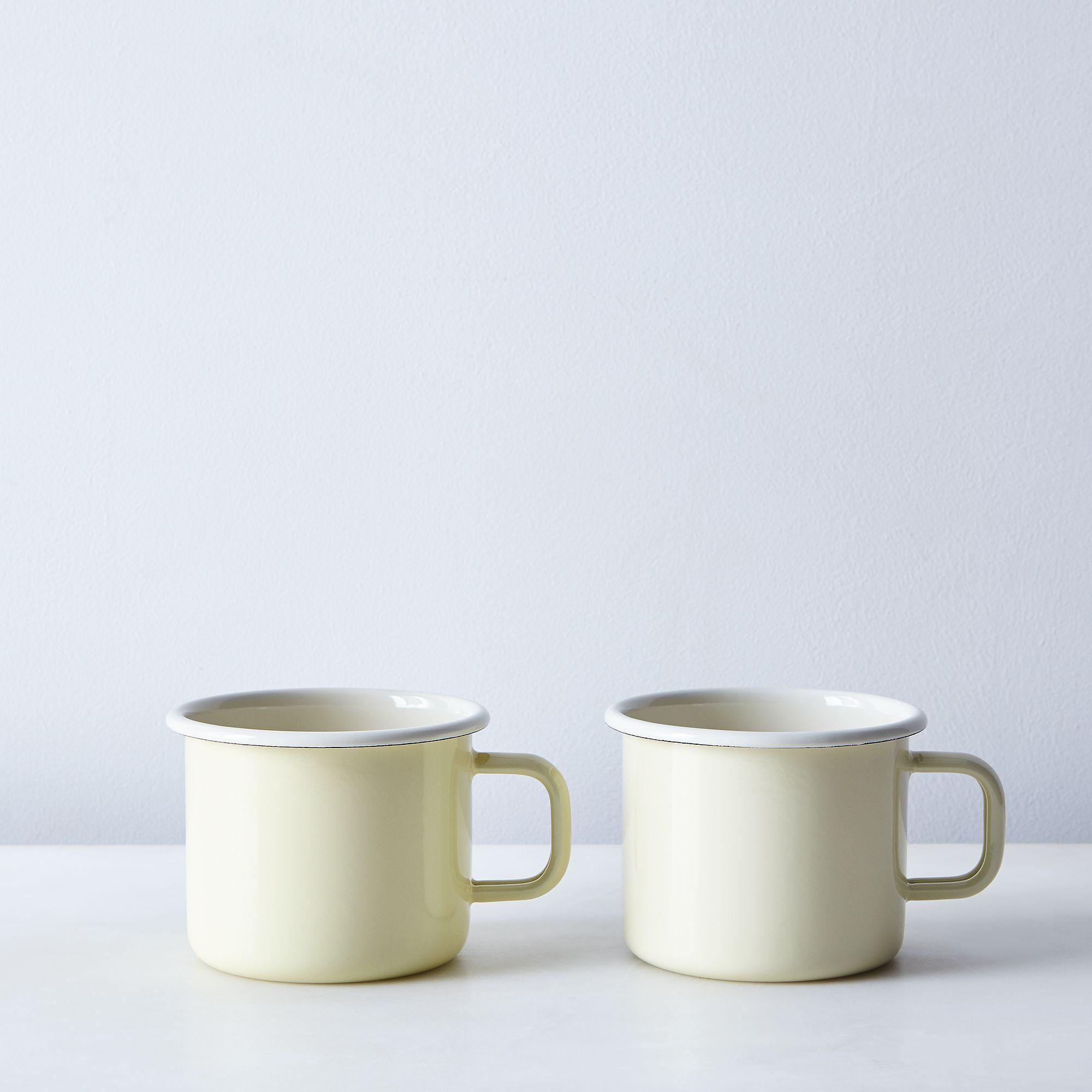 enamel mug (set of ) on food -