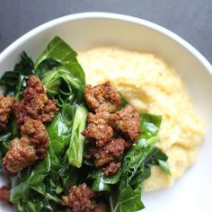 Marinated Collard Green Salad with Sausage and Gruyère Grits