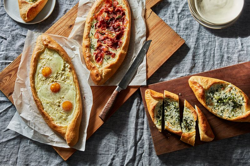 From left to right: egg and cheese, crispy prosciutto-rosemary, and green khachapuri.