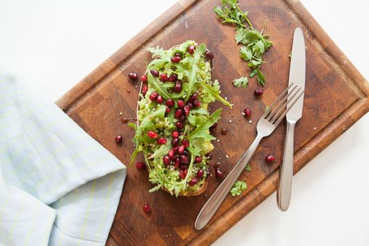 Superfood avocado toast with pomegranate seeds